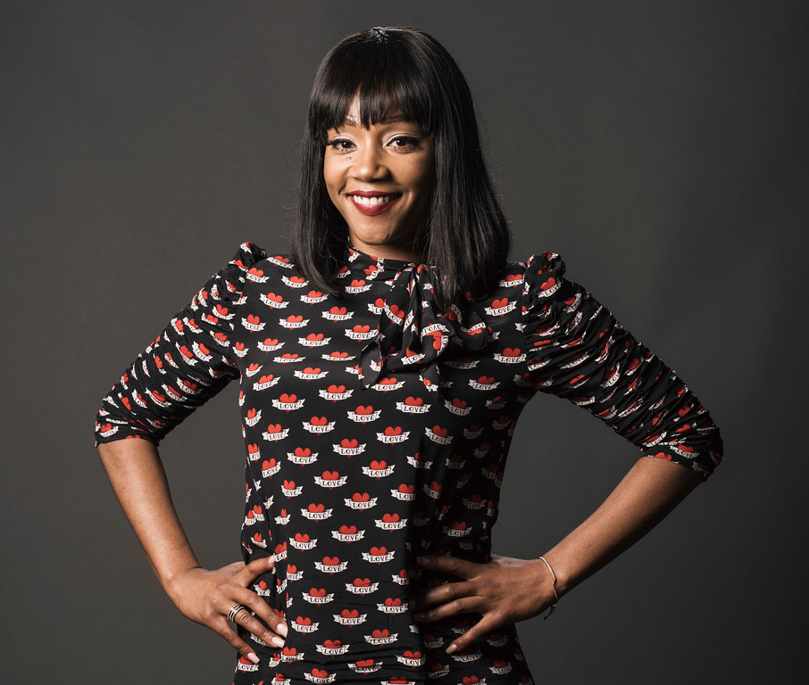 ". FILE - In this July 27, 2017 file photo, Tiffany Haddish poses for a portrait while promoting ""The Last O.G.\"" during the Television Critics Association Summer Press Tour in Beverly Hills, Calif. Haddish got some love on Twitter for her fun-loving presentation of the Oscar nominees, including a few dance moves and a creative pronunciation or two. Haddish, a huge hit in �Girls Trip,� bantered her way through the proceedings, injecting some needed energy into the early morning affair and getting co-announcer Andy Serkis into the spirit. (Photo by Casey Curry/Invision/AP, File)"
