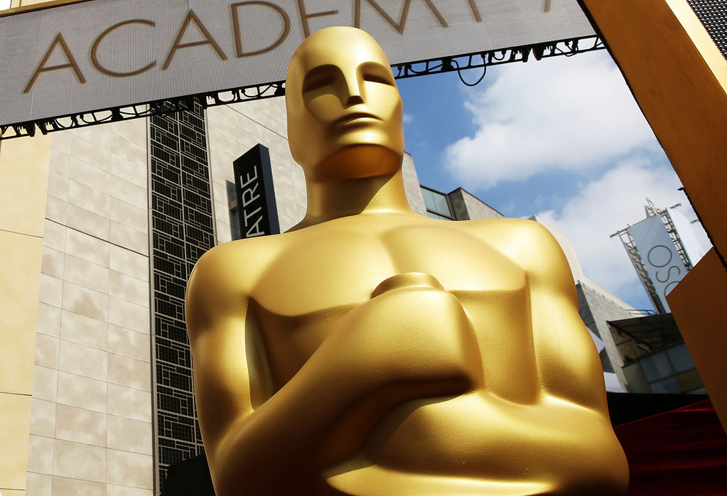 . FILE - In this Feb. 21, 2015 file photo, an Oscar statue appears outside the Dolby Theatre for the 87th Academy Awards in Los Angeles. Nominations for the 90th Academy Awards were announced on Tuesday, Jan. 23, 2018. (Photo by Matt Sayles/Invision/AP, File)