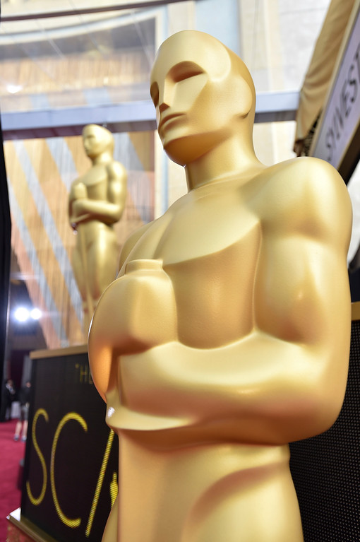 . FILE - In this Feb. 28, 2016 file photo, Oscar statues are displayed at the Oscars in Los Angeles.  Nominations for the 90th Academy Awards were announced on Tuesday, Jan. 23, 2018. (Photo by Jordan Strauss/Invision/AP, File)