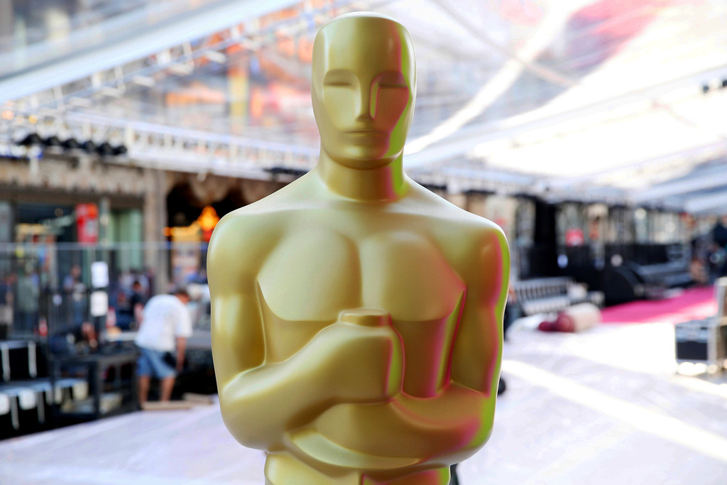. FILE - In this Feb. 24, 2016 file photo, an Oscar statue appears during the setup for the 88th Academy Awards in Los Angeles. Nominations for the 90th Academy Awards were announced on Tuesday, Jan. 23, 2018. (Photo by Matt Sayles/Invision/AP, File)
