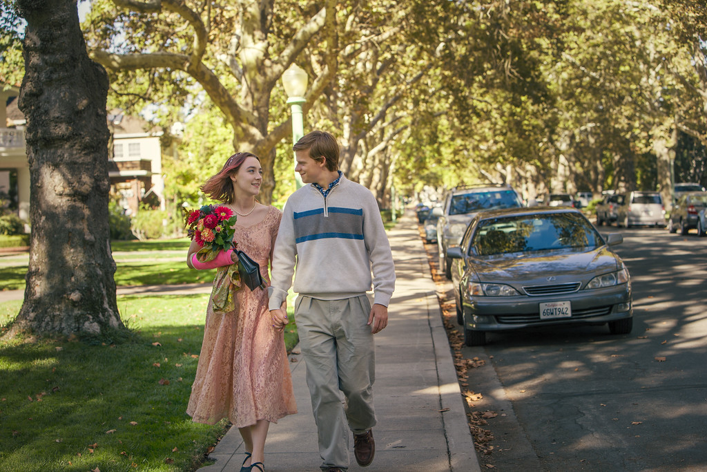 ". This image released by A24 Films shows Saoirse Ronan, left, and Lucas Hedges in a scene from ""Lady Bird.\"" The film was nominated for an Oscar for best picture on Tuesday, Jan. 23, 2018. The 90th Oscars will air live on ABC on Sunday, March 4.  (Merie Wallace/A24 via AP)"