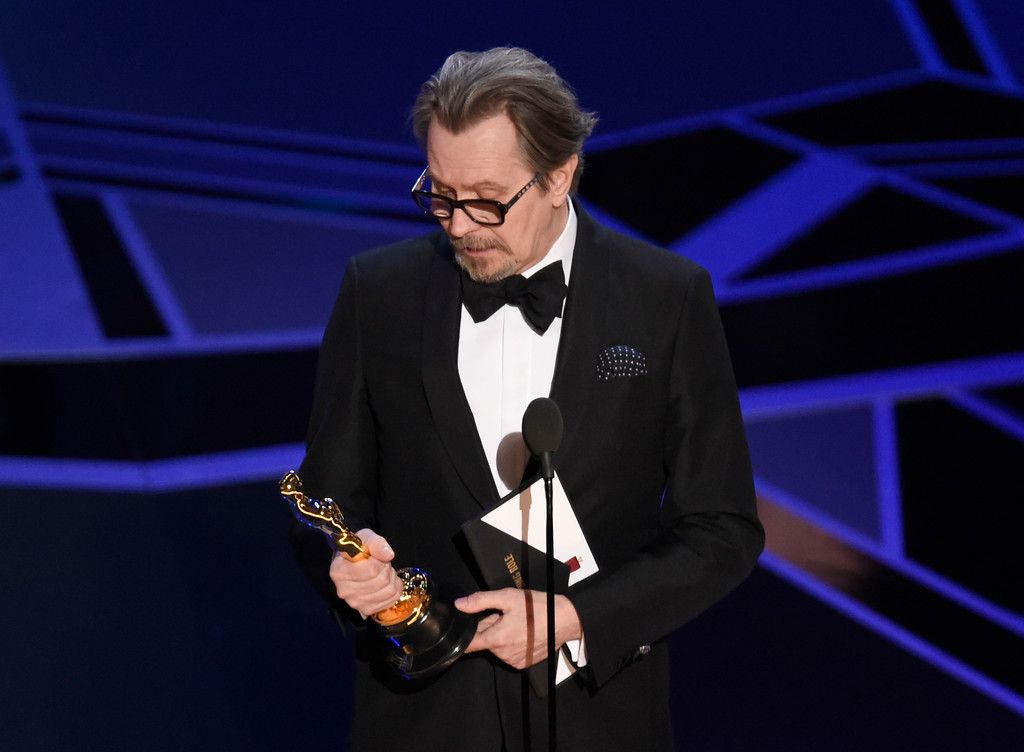". Gary Oldman accepts the award for best performance by an actor in a leading role for ""Darkest Hour\"" at the Oscars on Sunday, March 4, 2018, at the Dolby Theatre in Los Angeles. (Photo by Chris Pizzello/Invision/AP)"