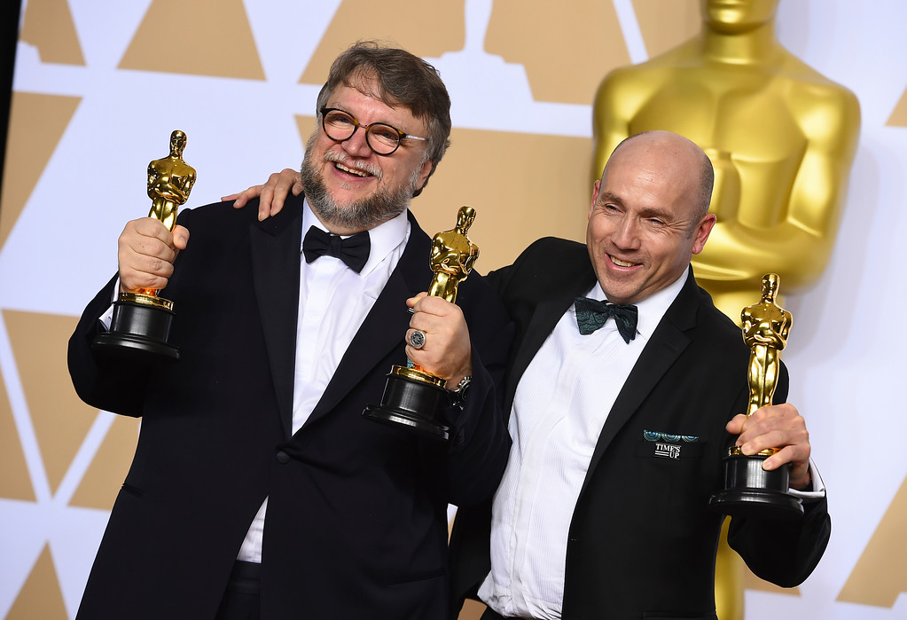 ". Guillermo del Toro, left, winner of the awards for best director for ""The Shape of Water\"" and best picture for \""The Shape of Water\"", and J. Miles Dale, winner of the award for best picture for \""The Shape of Water\"", pose in the press room at the Oscars on Sunday, March 4, 2018, at the Dolby Theatre in Los Angeles. (Photo by Jordan Strauss/Invision/AP)"