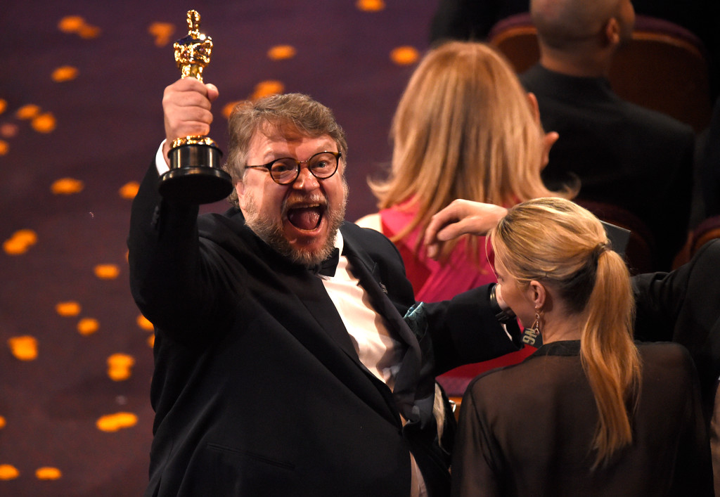 ". Guillermo del Toro, winner of the award for best director for ""The Shape of Water\"" celebrates in the audience at the Oscars on Sunday, March 4, 2018, at the Dolby Theatre in Los Angeles. (Photo by Chris Pizzello/Invision/AP)"