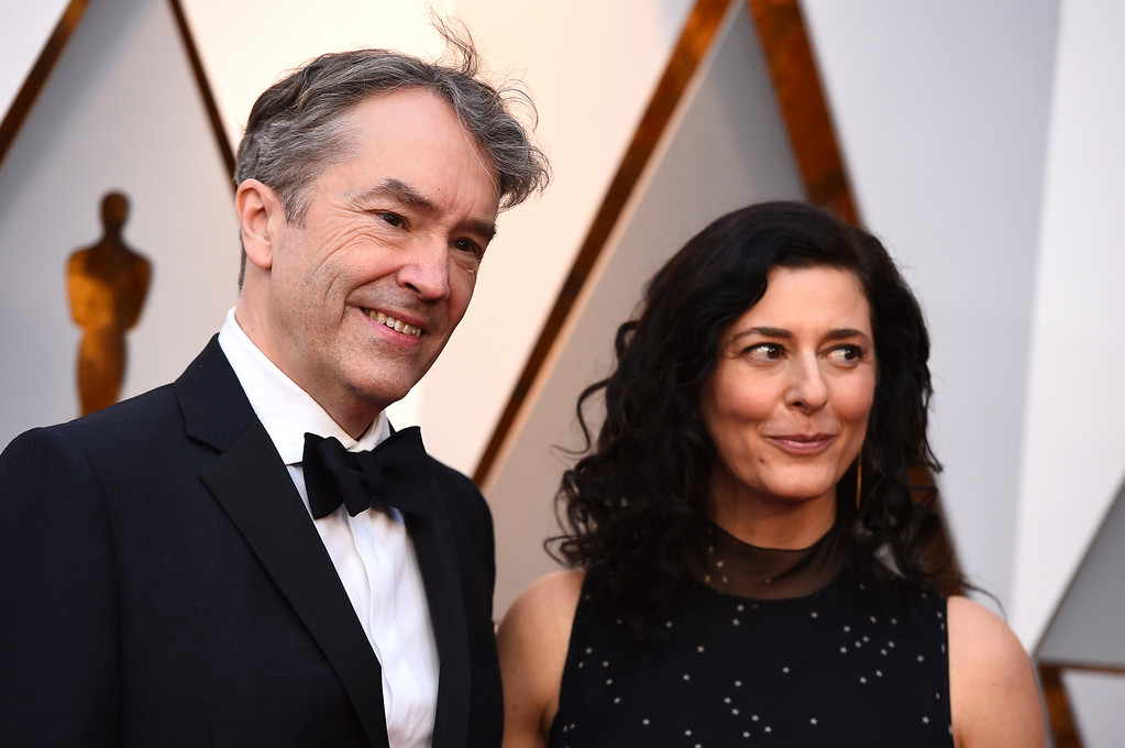 . Carter Burwell, left, and Christine Sciulli arrive at the Oscars on Sunday, March 4, 2018, at the Dolby Theatre in Los Angeles. (Photo by Jordan Strauss/Invision/AP)