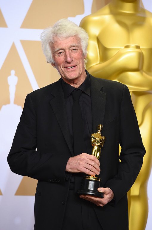". Roger Deakins, winner of the award for best cinematography for ""Blade Runner 2049\"", poses in the press room at the Oscars on Sunday, March 4, 2018, at the Dolby Theatre in Los Angeles. (Photo by Jordan Strauss/Invision/AP)"