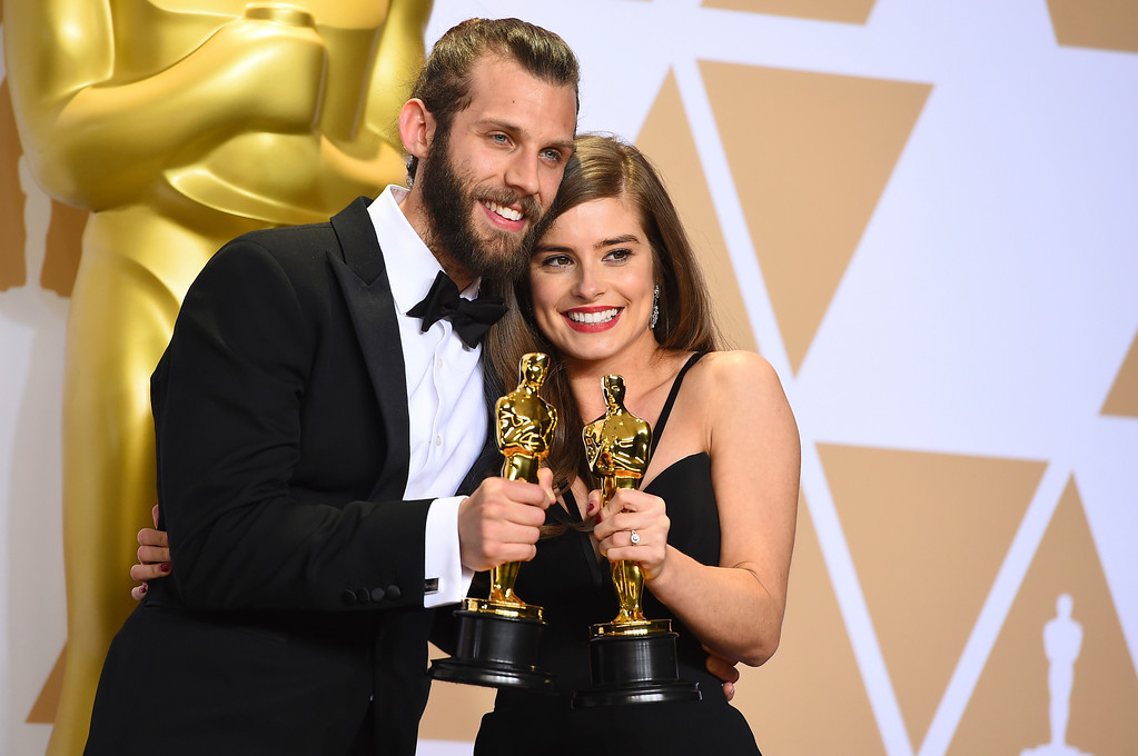 ". Chris Overton, left, and Rachel Shenton, winners of the award for best live action short for ""The Silent Child\"", pose in the press room at the Oscars on Sunday, March 4, 2018, at the Dolby Theatre in Los Angeles. (Photo by Jordan Strauss/Invision/AP)"