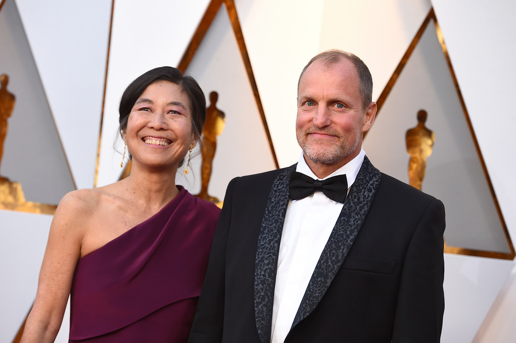 . Laura Louie, left, and Woody Harrelson arrive at the Oscars on Sunday, March 4, 2018, at the Dolby Theatre in Los Angeles. (Photo by Jordan Strauss/Invision/AP)