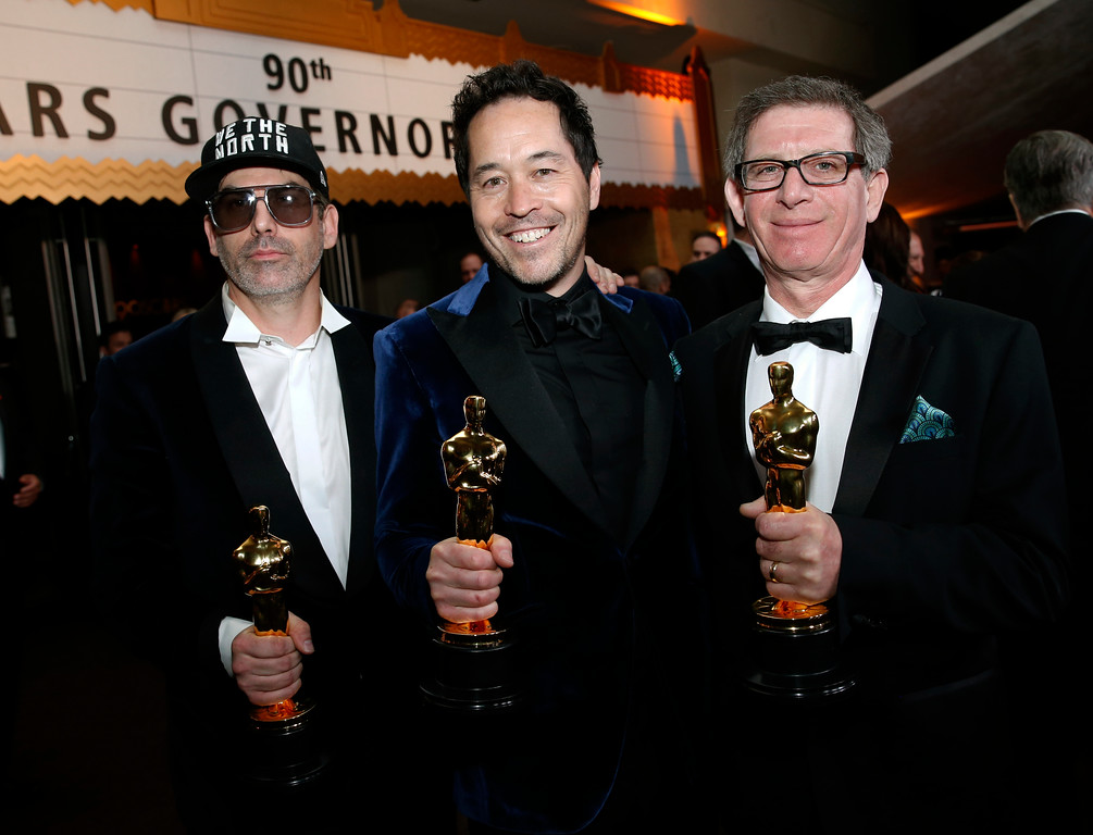 ". Shane Vieau, from left, Paul D. Austerberry, and Jeffrey A Melvin, winners of the award for best production design for ""The Shape of Water\"", attend the Governors Ball after the Oscars on Sunday, March 4, 2018, at the Dolby Theatre in Los Angeles. (Photo by Eric Jamison/Invision/AP)"