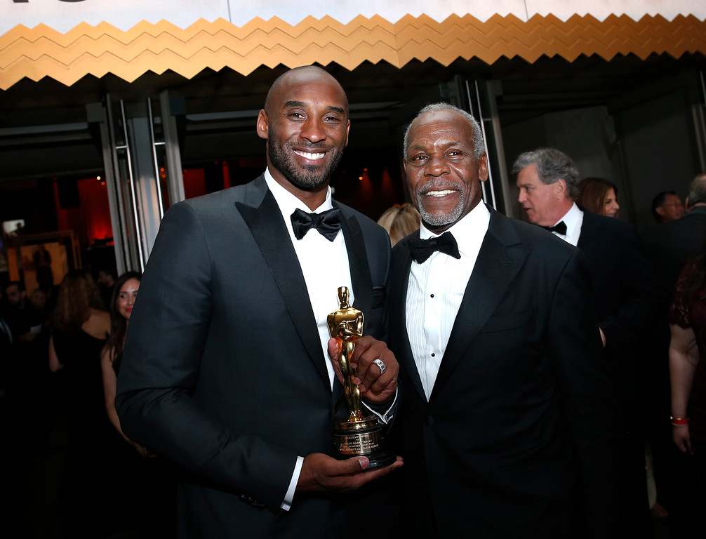 ". Kobe Bryant, winner of the award for best animated short for ""Dear Basketball\"", left, and Danny Glover attend the Governors Ball after the Oscars on Sunday, March 4, 2018, at the Dolby Theatre in Los Angeles. (Photo by Eric Jamison/Invision/AP)"