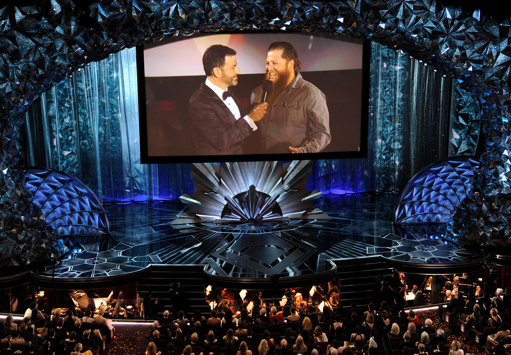 . Host Jimmy Kimmel, left, speaks with a member of the movie theater audience on screen via satellite at the Oscars on Sunday, March 4, 2018, at the Dolby Theatre in Los Angeles. (Photo by Chris Pizzello/Invision/AP)