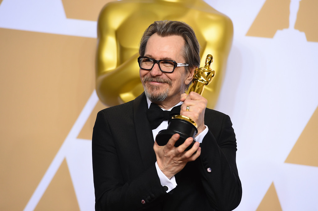". Gary Oldman, winner of the award for best performance by an actor in a leading role for ""Darkest Hour\"", poses in the press room at the Oscars on Sunday, March 4, 2018, at the Dolby Theatre in Los Angeles. (Photo by Jordan Strauss/Invision/AP)"