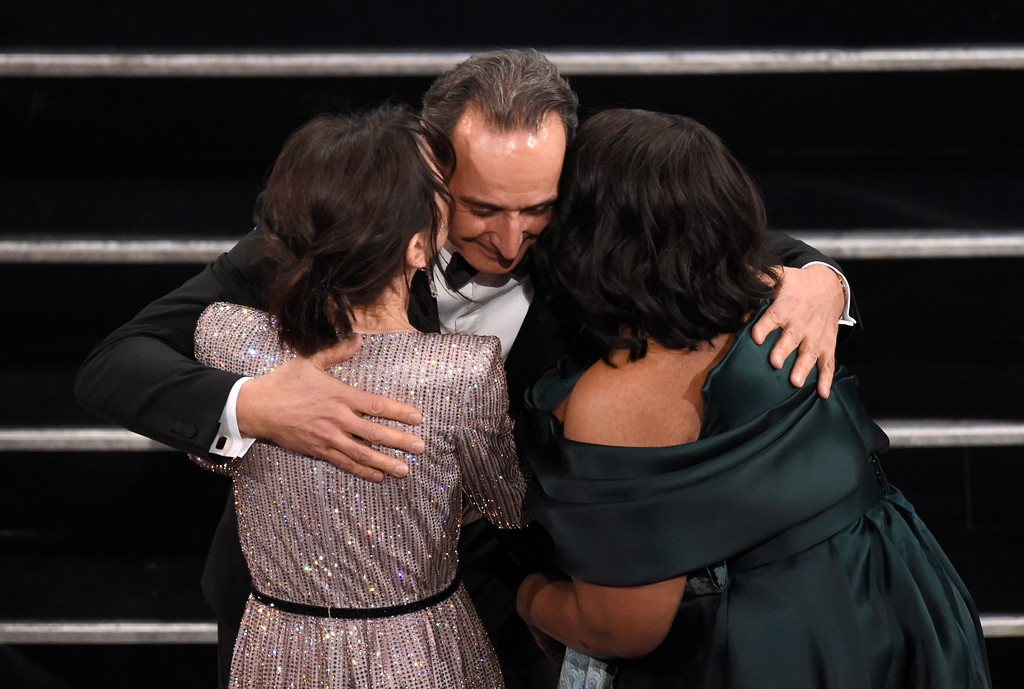 ". Sally Hawkins, left, and Octavia Spencer, right, congratulate Alexandre Desplat, winner of the award for best original score for ""The Shape of Water\"" in the audience at the Oscars on Sunday, March 4, 2018, at the Dolby Theatre in Los Angeles. (Photo by Chris Pizzello/Invision/AP)"