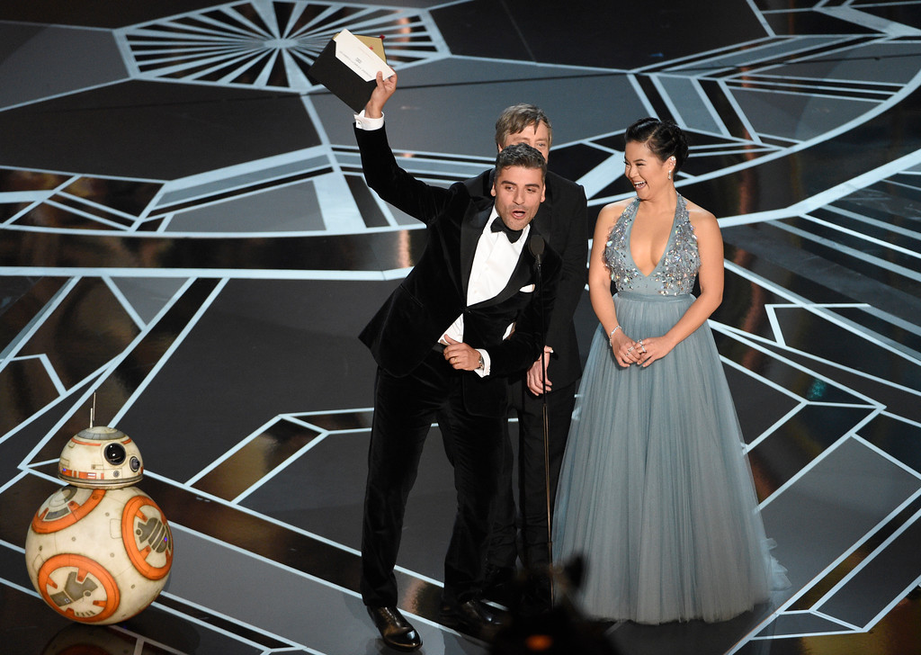 . BB-8, from left, Oscar Isaacs, Mark Hamill and Kelly Marie Tran present the award for best animated short at the Oscars on Sunday, March 4, 2018, at the Dolby Theatre in Los Angeles. (Photo by Chris Pizzello/Invision/AP)