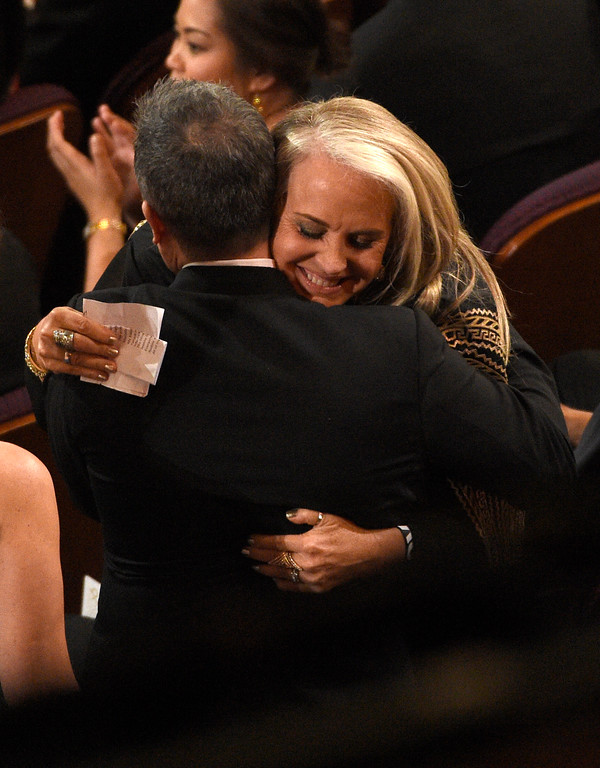 ". Lee Unkrich, left, and Darla K. Anderson embrace after winning the award for best animated feature film for ""Coco\"" at the Oscars on Sunday, March 4, 2018, at the Dolby Theatre in Los Angeles. (Photo by Chris Pizzello/Invision/AP)"