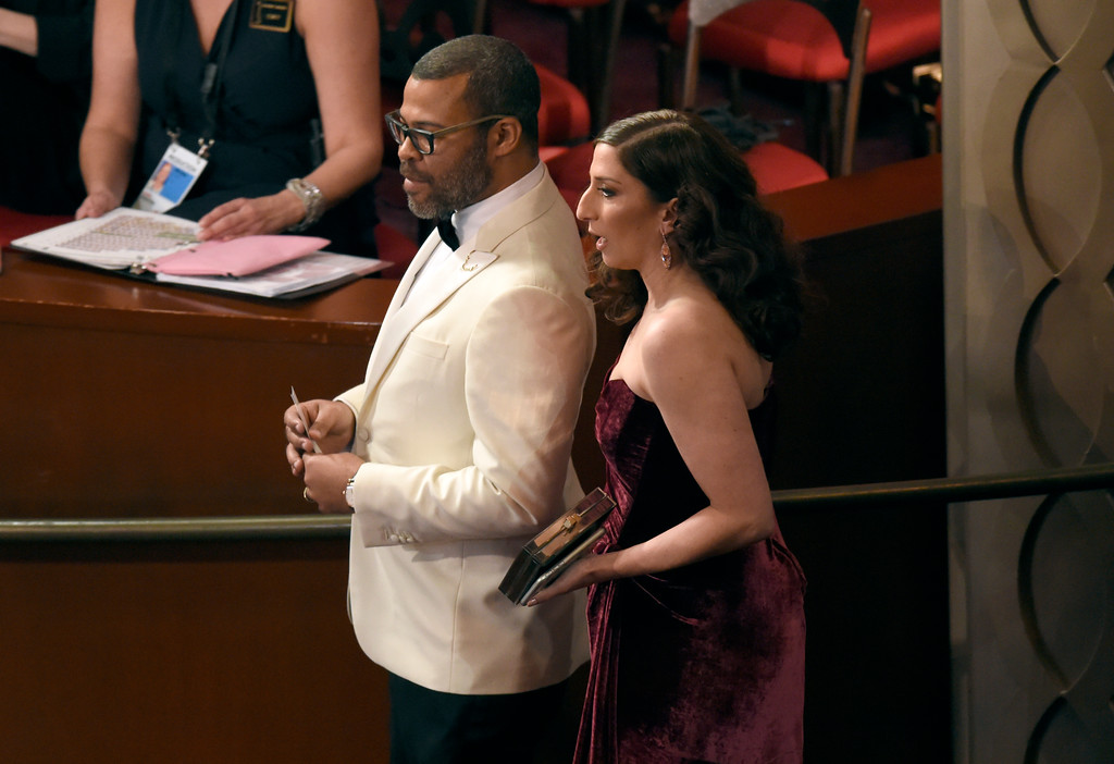 . Jordan Peele, left, and Chelsea Peretti appear in the audience at the Oscars on Sunday, March 4, 2018, at the Dolby Theatre in Los Angeles. (Photo by Chris Pizzello/Invision/AP)
