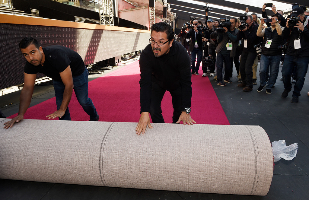 . Crew members roll out the red carpet for Sunday\'s 90th Academy Awards, outside the Dolby Theatre on Wednesday, Feb. 28, 2018, in Los Angeles. (Photo by Chris Pizzello/Invision/AP)