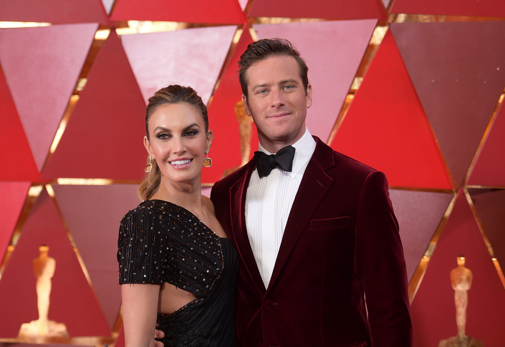 . Elizabeth Chambers, left, and Armie Hammer arrive at the Oscars on Sunday, March 4, 2018, at the Dolby Theatre in Los Angeles. (Photo by Richard Shotwell/Invision/AP)