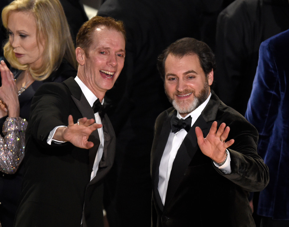 ". Doug Jones, left, and Michael Stuhlbarg celebrate with the cast and crew after accepting the award for best picture for ""The Shape of Water\"" at the Oscars on Sunday, March 4, 2018, at the Dolby Theatre in Los Angeles. (Photo by Chris Pizzello/Invision/AP)"