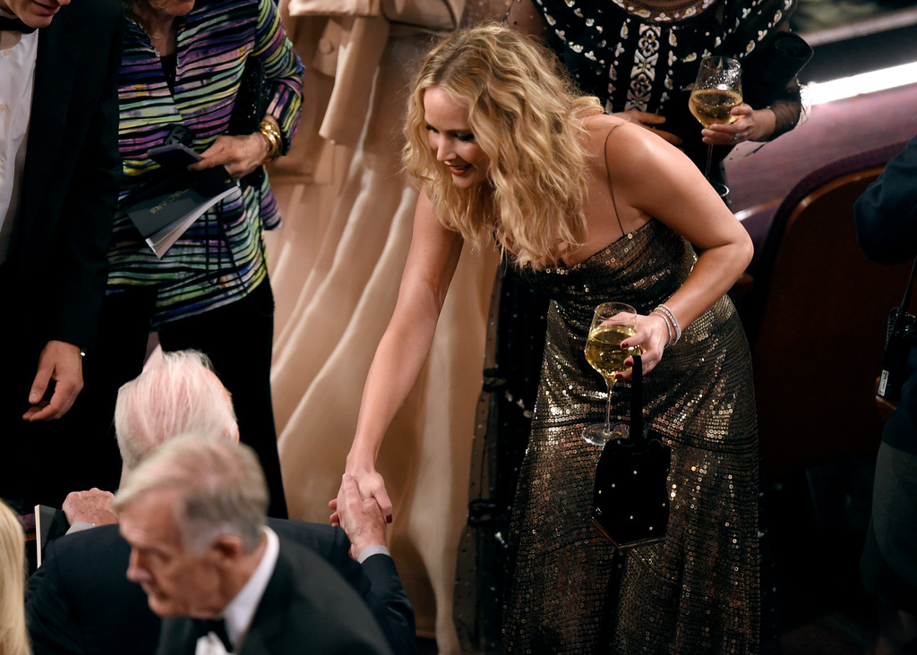 . Jennifer Lawrence, right, greets Christopher Plummer in the audience at the Oscars on Sunday, March 4, 2018, at the Dolby Theatre in Los Angeles. (Photo by Chris Pizzello/Invision/AP)