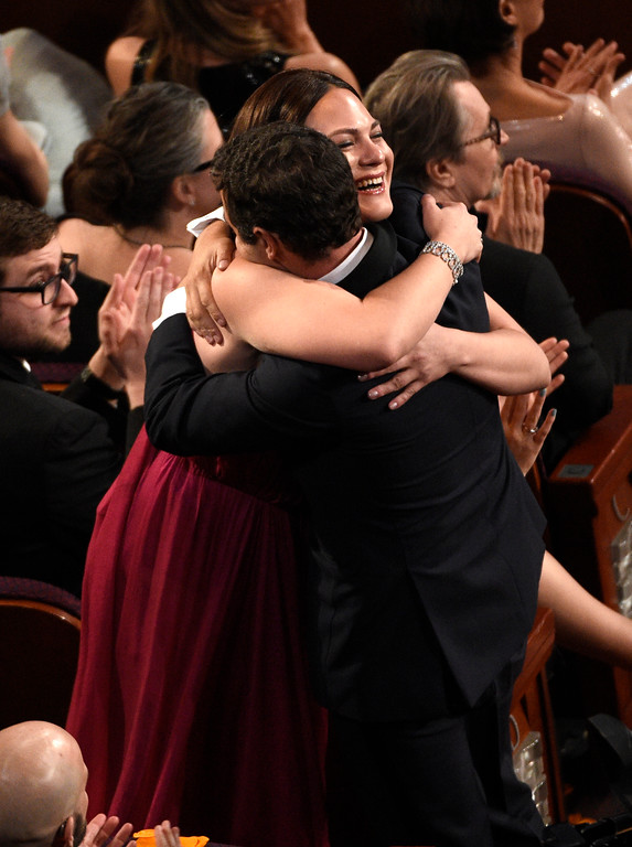 ". Nicolas Saavedra, right, and Daniela Vega, winners of the award for best foreign language film for ""A Fantastic Woman,\"" hug in the audience at the Oscars on Sunday, March 4, 2018, at the Dolby Theatre in Los Angeles. (Photo by Chris Pizzello/Invision/AP)"