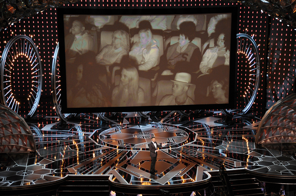 . Host Jimmy Kimmel speaks as an audience appears via satellite at the Oscars on Sunday, March 4, 2018, at the Dolby Theatre in Los Angeles. (Photo by Chris Pizzello/Invision/AP)