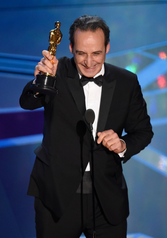 ". Alexandre Desplat accepts the award for best original score for ""The Shape of Water\"" at the Oscars on Sunday, March 4, 2018, at the Dolby Theatre in Los Angeles. (Photo by Chris Pizzello/Invision/AP)"