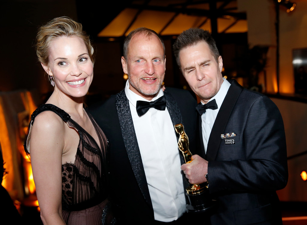 ". Leslie Bibb, from left, Woody Harrelson and Sam Rockwell, winner of the award for best performance by an actor in a supporting role for ""Three Billboards Outside Ebbing, Missouri\"", attend the Governors Ball after the Oscars on Sunday, March 4, 2018, at the Dolby Theatre in Los Angeles. (Photo by Eric Jamison/Invision/AP)"