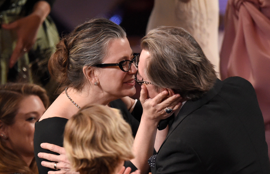 ". Gisele Schmidt, left, kisses husband Gary Oldman, winner of the award for best performance by an actor in a leading role for ""Darkest Hour\"" at the Oscars on Sunday, March 4, 2018, at the Dolby Theatre in Los Angeles. (Photo by Chris Pizzello/Invision/AP)"