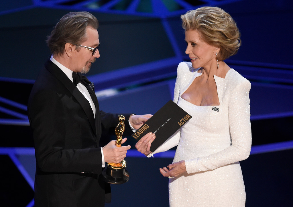 ". Jane Fonda, right, presents Gary Oldman with the award for best performance by an actor in a leading role for ""Darkest Hour\"" at the Oscars on Sunday, March 4, 2018, at the Dolby Theatre in Los Angeles. (Photo by Chris Pizzello/Invision/AP)"