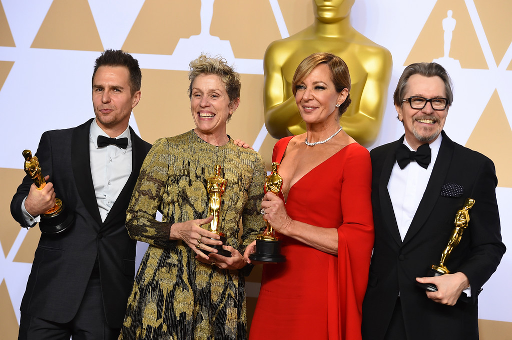 ". Sam Rockwell, from left, winner of the award for best performance by an actor in a supporting role for ""Three Billboards Outside Ebbing, Missouri\"", Frances McDormand, winner of the award for best performance by an actress in a leading role for \""Three Billboards Outside Ebbing, Missouri\"", Allison Janney, winner of the award for best performance by an actress in a supporting role for \""I, Tonya\"", and Gary Oldman, winner of the award for best performance by an actor in a leading role for \""Darkest Hour\"", pose in the press room at the Oscars on Sunday, March 4, 2018, at the Dolby Theatre in Los Angeles. (Photo by Jordan Strauss/Invision/AP)"