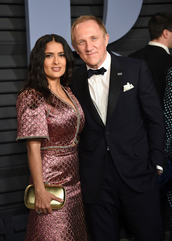 . Selma Hayek, left, and Francois-Henri Pinault arrive at the Vanity Fair Oscar Party on Sunday, March 4, 2018, in Beverly Hills, Calif. (Photo by Evan Agostini/Invision/AP)