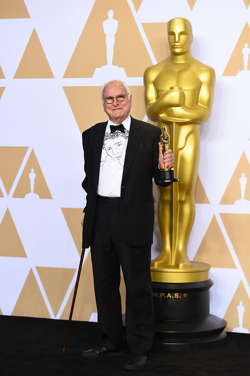 ". James Ivory, winner of the award for best adapted screenplay for ""Call Me by Your Name\"", poses in the press room at the Oscars on Sunday, March 4, 2018, at the Dolby Theatre in Los Angeles. (Photo by Jordan Strauss/Invision/AP)"