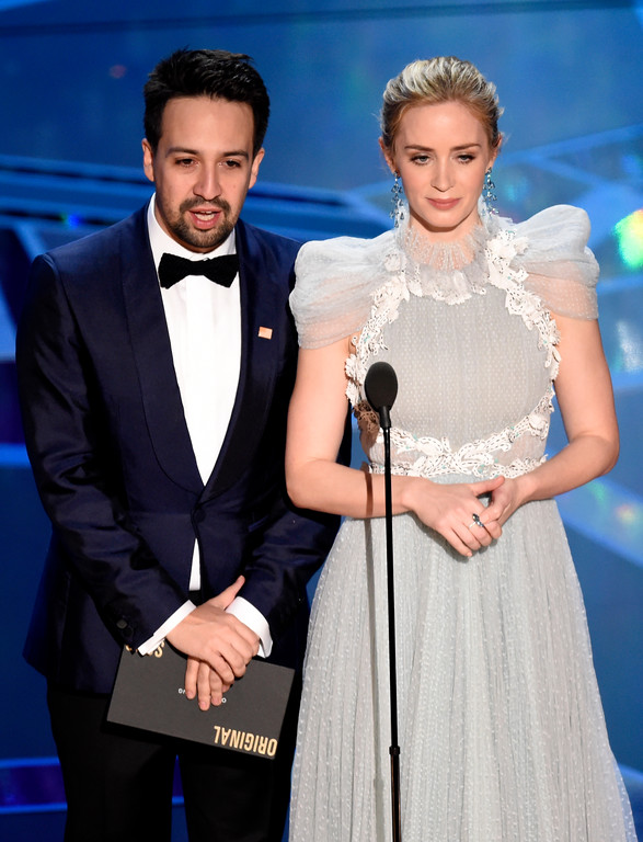 . Lin-Manuel Miranda, left, and Emily Blunt present the award for best original song at the Oscars on Sunday, March 4, 2018, at the Dolby Theatre in Los Angeles. (Photo by Chris Pizzello/Invision/AP)