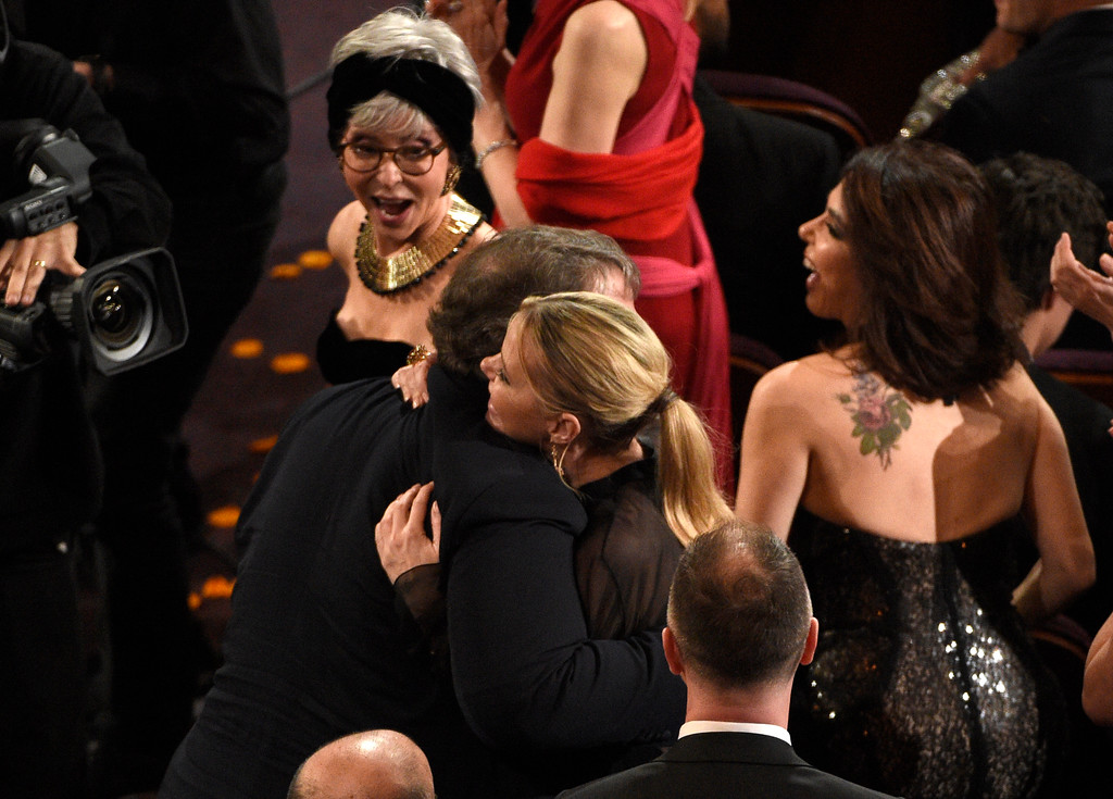 ". Guillermo del Toro, left, winner of the award for best director for ""The Shape of Water\"" is congratulated by Kim Morgan as Rita Moreno, background left, looks on at the Oscars on Sunday, March 4, 2018, at the Dolby Theatre in Los Angeles. (Photo by Chris Pizzello/Invision/AP)"