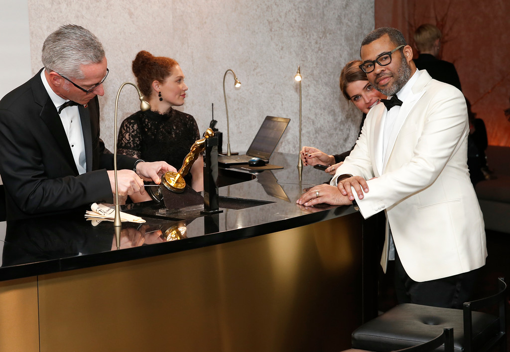 . Jordan Peele picks up his Oscar as he attends the Governors Ball after the Oscars on Sunday, March 4, 2018, at the Dolby Theatre in Los Angeles. (Photo by Eric Jamison/Invision/AP)