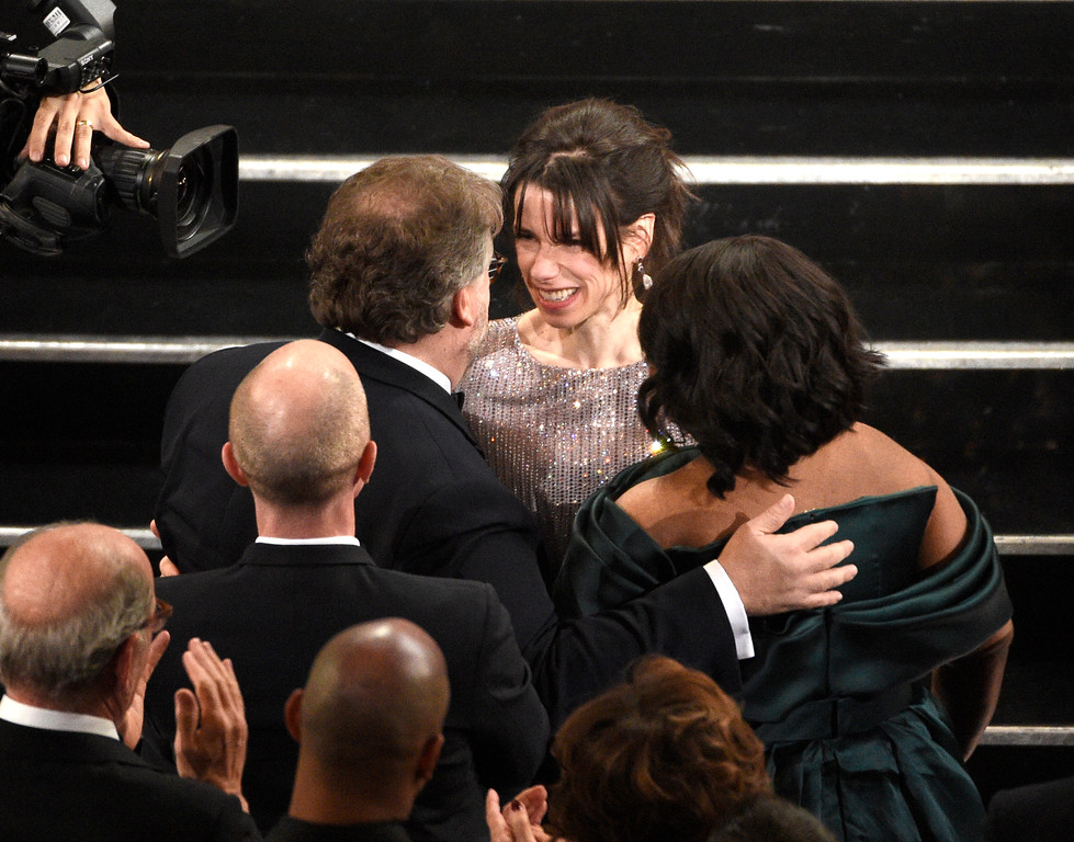 ". Guillermo del Toro, from left, is congratulated by Sally Hawkins and Octavia Spencer before going on stage to accept the award for best director for ""The Shape of Water\"" at the Oscars on Sunday, March 4, 2018, at the Dolby Theatre in Los Angeles. (Photo by Chris Pizzello/Invision/AP)"