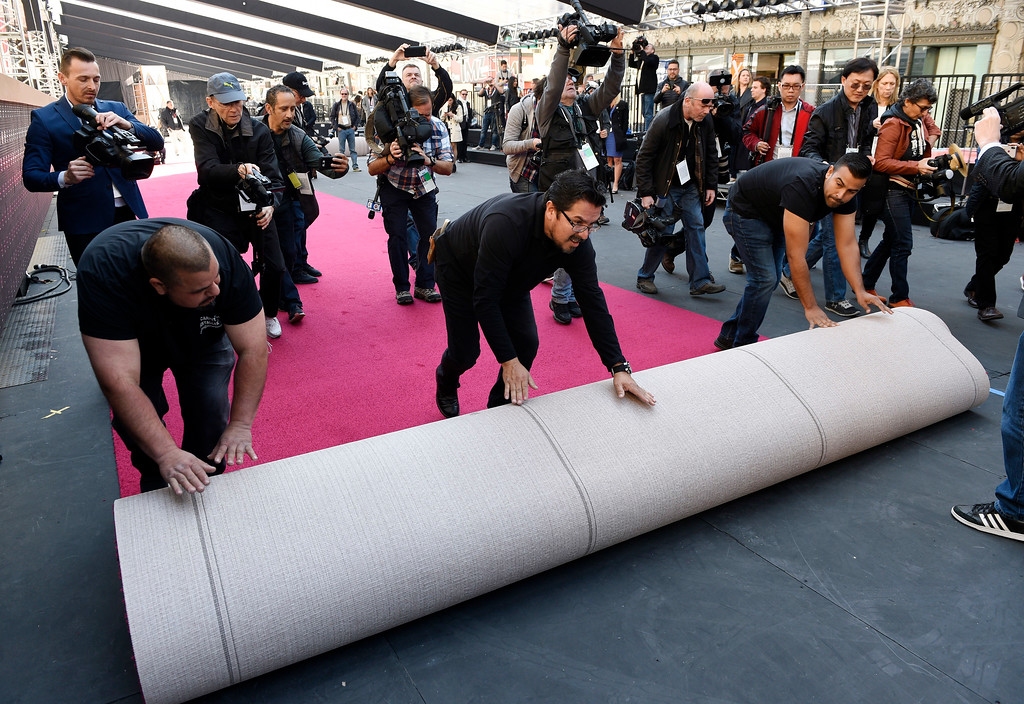 . Crew members are trailed by media as they roll out the red carpet for Sunday\'s 90th Academy Awards in front of the Dolby Theatre on Wednesday, Feb. 28, 2018, in Los Angeles. (Photo by Chris Pizzello/Invision/AP)
