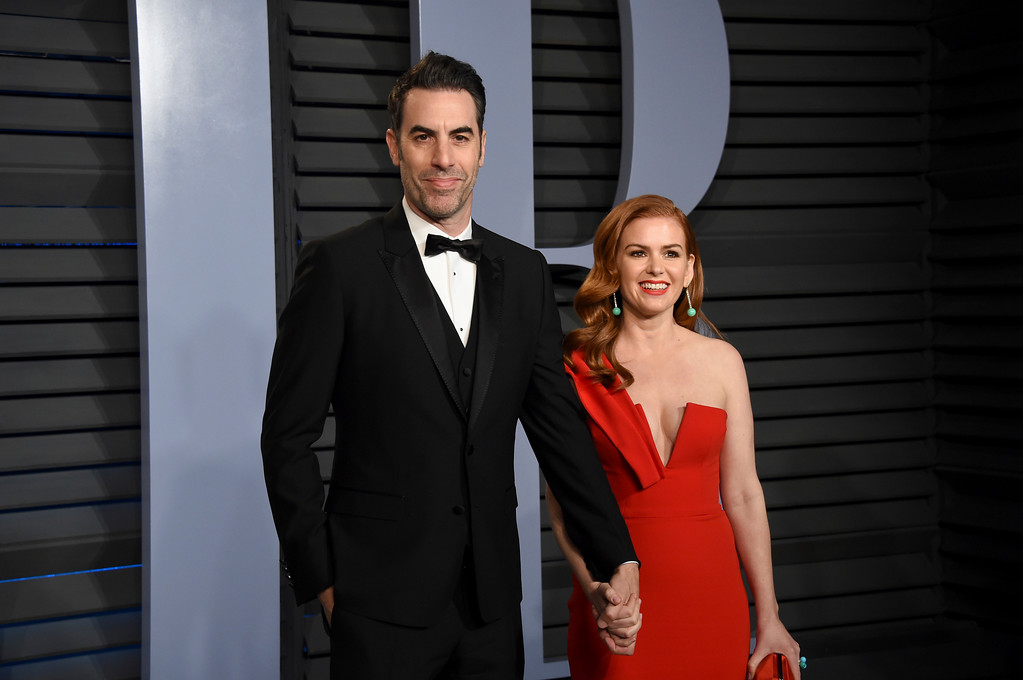. Sacha Baron Cohen, left, and Isla Fisher arrive at the Vanity Fair Oscar Party on Sunday, March 4, 2018, in Beverly Hills, Calif. (Photo by Evan Agostini/Invision/AP)