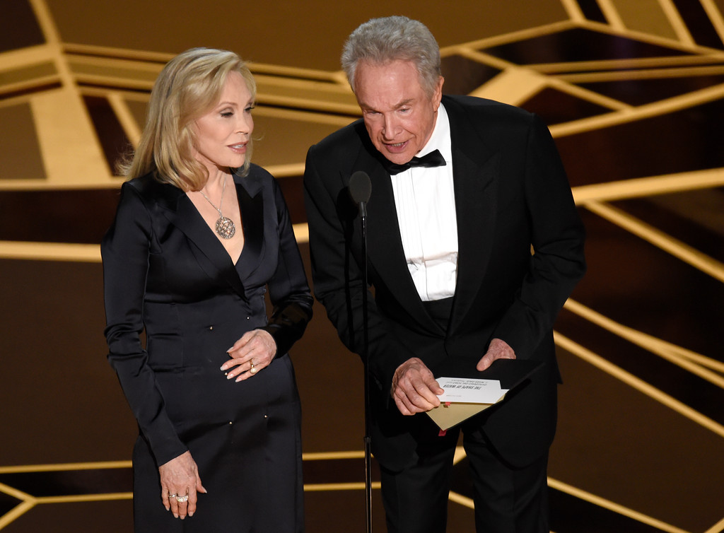 . Faye Dunaway, left, and Warren Beatty present the award for best picture at the Oscars on Sunday, March 4, 2018, at the Dolby Theatre in Los Angeles. (Photo by Chris Pizzello/Invision/AP)