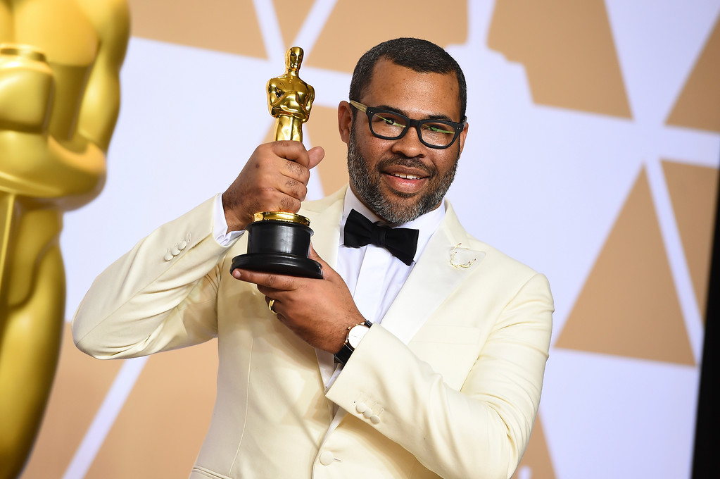 ". Jordan Peele, winner of the award for best original screenplay for ""Get Out\"", poses in the press room at the Oscars on Sunday, March 4, 2018, at the Dolby Theatre in Los Angeles. (Photo by Jordan Strauss/Invision/AP)"