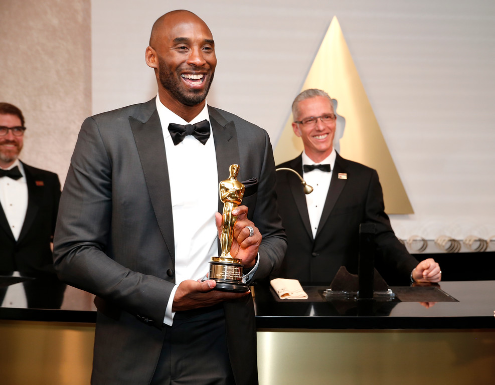 ". Kobe Bryant, winner of the award for best animated short for ""Dear Basketball\"", attends the Governors Ball after the Oscars on Sunday, March 4, 2018, in Los Angeles. (Photo by Eric Jamison/Invision/AP)"