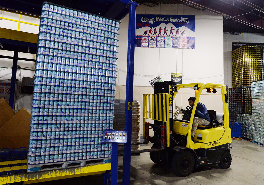 . LONGMONT, CO - October 12, 2018: Manny Arellano moves water cans to be filled. Thousands of units of water are being canned at Oskar Blues in Longmont on Friday for Hurricane Michael relief. The Can\'d Aid Foundation has partnered with Oskar Blues Brewery and Ball Corporation  to provide canned water for disaster relief.   (Photo by Cliff Grassmick/Staff Photographer)