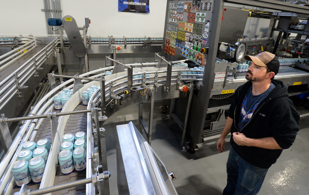 . LONGMONT, CO - October 12, 2018: Allen Prupp monitors the progress of the water being canned. Thousands of units of water are being canned at Oskar Blues in Longmont on Friday for Hurricane Michael relief. The Can\'d Aid Foundation has partnered with Oskar Blues Brewery and Ball Corporation  to provide canned water for disaster relief.   (Photo by Cliff Grassmick/Staff Photographer)