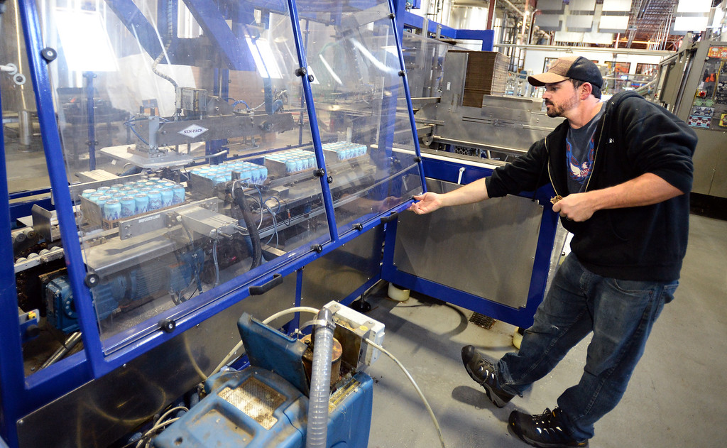 . LONGMONT, CO - October 12, 2018: Allen Prupp keeps the canning  line moving. Thousands of units of water are being canned at Oskar Blues in Longmont on Friday for Hurricane Michael relief. The Can\'d Aid Foundation has partnered with Oskar Blues Brewery and Ball Corporation  to provide canned water for disaster relief.   (Photo by Cliff Grassmick/Staff Photographer)