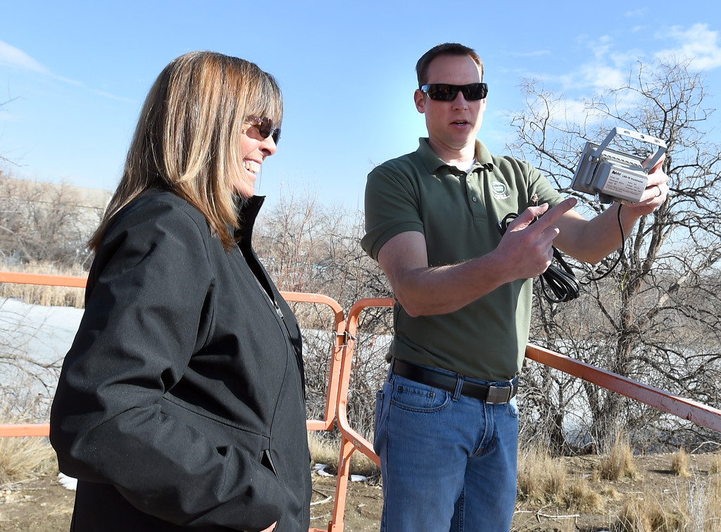 . Nik Brockman, right, describes how the the light works to volunteer, Stephanie Powers.  Nik Brockman, of Boulder County Parks and Open Space, replaces an infrared light at the osprey nest at the Boulder County Fairgrounds in Longmont. The light allows people to see the birds at night from the mounted camera.  Cliff Grassmick / Staff Photographer/ March 1, 2018