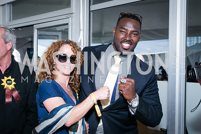 Aimee Brisson, Arthur Jones. Photo by Alfredo Flores. 139th Running of the Preakness. Pimlico Race Course. May 17, 2014.