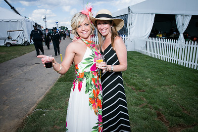 Carey Griffith Edwards, Barbie Monares. Photo by Alfredo Flores. 139th Running of the Preakness. Pimlico Race Course. May 17, 2014.