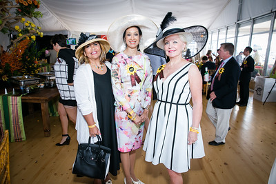 Charo Abrams, Linda Awkard, Carole Randolph. Photo by Alfredo Flores. 139th Running of the Preakness. Pimlico Race Course. May 17, 2014.