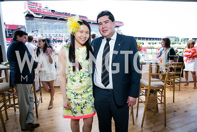 Erin Yiu, Juan Montoya. Photo by Alfredo Flores. 139th Running of the Preakness. Pimlico Race Course. May 17, 2014.